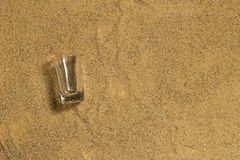 Glass on the sand. Show for material made glass Royalty Free Stock Image