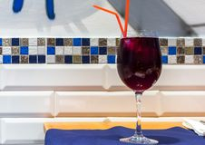 Glass of Sangria wine with two red straws royalty free stock photography