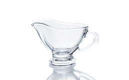 Glass sauceboat on white background. With reflection Stock Images