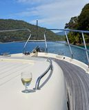 Glass of Sauvignon Blanc Wine on Luxury Motor Boat royalty free stock photos