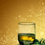 Glass of scotch on abstract background Royalty Free Stock Image