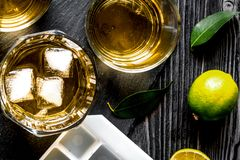 Glass of scotch on dark wooden background top view Stock Image