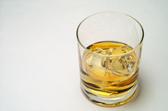 Glass of scotch and ice. Horizontal Royalty Free Stock Photo