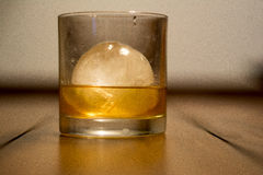 Glass of scotch with ice Royalty Free Stock Images