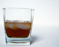 A glass of scotch with ice on a white background Stock Photo