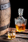 Glass of Scotch and old oak barrel Royalty Free Stock Photos