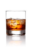 Glass of scotch whiskey and ice Royalty Free Stock Images
