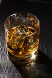 Glass of scotch whiskey with ice Royalty Free Stock Photography