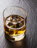Glass of scotch whiskey with ice Stock Photo