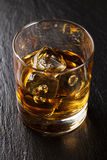 Glass of scotch whiskey with ice Stock Images