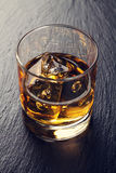 Glass of scotch whiskey with ice Stock Image