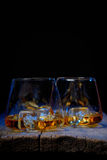 Glass of scotch whiskey and ice isolated Stock Images