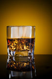 Glass of scotch whiskey and ice Stock Photography