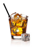 Glass of scotch whiskey and ice Royalty Free Stock Photography