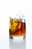 Glass of scotch whiskey and  ice on a white background Stock Image
