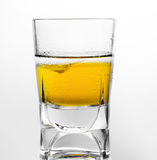 Glass of scotch whiskey and ice on a white background Royalty Free Stock Image