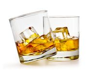 Glass of scotch whiskey. And ice on a white background with clipping path Stock Image