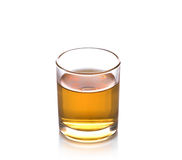 Glass of scotch whiskey isolated over white background. Royalty Free Stock Photo