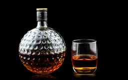 Glass of scotch whiskey and old decanter stock images