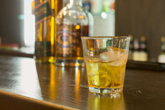 Glass of scotch or whiskey on the rocks Royalty Free Stock Images