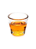 Glass of scotch whiskey on white background. Glass of scotch whiskey isolated over white background Royalty Free Stock Image