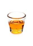 Glass of scotch whiskey on white background Royalty Free Stock Image