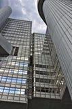 Glass scyscraper. Skyscraper with glass windows reflecting the sky Royalty Free Stock Photo