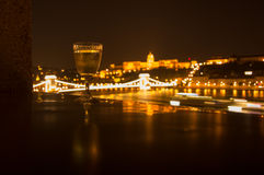 Glass set against the night Budapest. Glass of white wine set against the night Budapest stock photography
