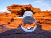 Glass sfär med den Kalbarri nationalparken - solnedgång Australien Royaltyfria Bilder