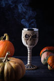 Glass in the shape a skull with Halloween drink Royalty Free Stock Photography