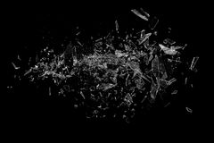 Glass shards on black. Shards of glass on black background floating in air royalty free stock photo
