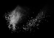 Glass shards flying. A bunch of glass shards and dust flying in the air stock photo
