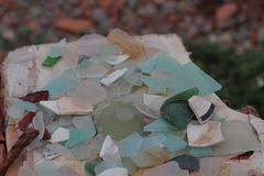 Glass shards on the table. Glass shards on the wooden table stock photos