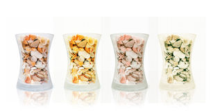 Glass of shells. Shells in glass jar, photo taken on January 12th,2010 Royalty Free Stock Images