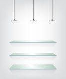 Glass shelves with spot light Royalty Free Stock Photo