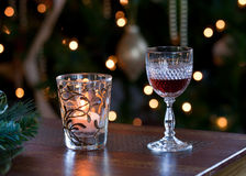 Glass of sherry with candle. Glass of sherry or port in front of out of focus christmas tree and lit by a candle stock images