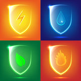 Glass shield icon set. Transparent glass shield icon set with nature symbols stock illustration