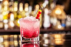 Glass of shirley temple cocktail decorated with cherry royalty free stock images