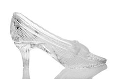 Glass shoe and reflection on white Royalty Free Stock Photos