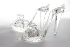 Glass shoes. Flip-flops made from glass Royalty Free Stock Photo