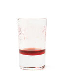Glass shot with grenadine leftovers Stock Photography