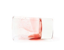 Glass shot with grenadine leftovers Royalty Free Stock Photography
