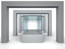 Glass showcase in grey room with columns Stock Photos