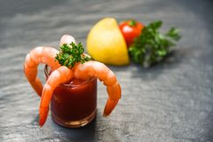 Glass shrimp cocktail in tomato sauce / Shellfish seafood boiled Shrimps prawns ketchup stock images
