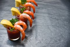 Glass shrimp cocktail in tomato sauce stock photography