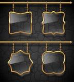 Glass signboards in golden frames Stock Photos