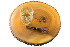 Glass of single malt scotch whisky, aromatic pipe tobacco on woo Royalty Free Stock Image