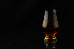 Glass with single malt whisky Stock Images