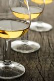Glass with single malt whisky on wooden board. In vertical format royalty free stock photo