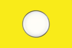 Glass of skim milk on a yellow background Stock Photos